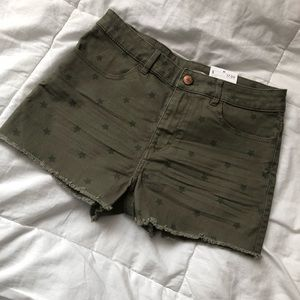 Olive green girl shorts with star print